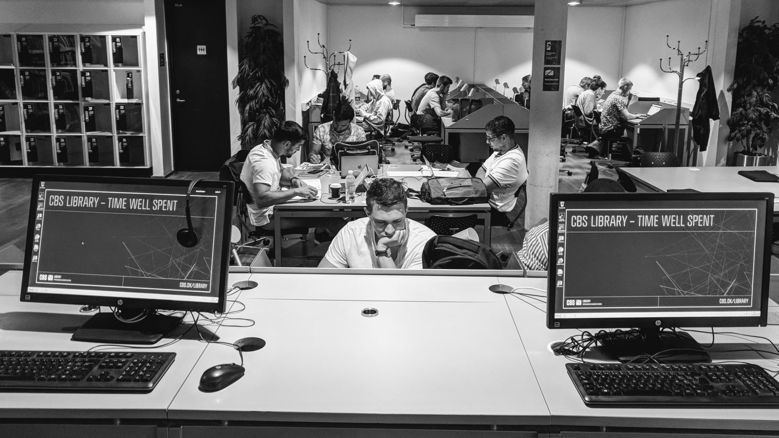 The atmosphere at CBS' campus: We chose the photo from the library because it precisely encapsulates the atmosphere when students are concentrating and preparing for their exams. We also found the photo to be very stylish andelegant, it draws the viewer in and results in them looking at it for a while.(Photo by Niels Jakob Kyhl Jørgensen)