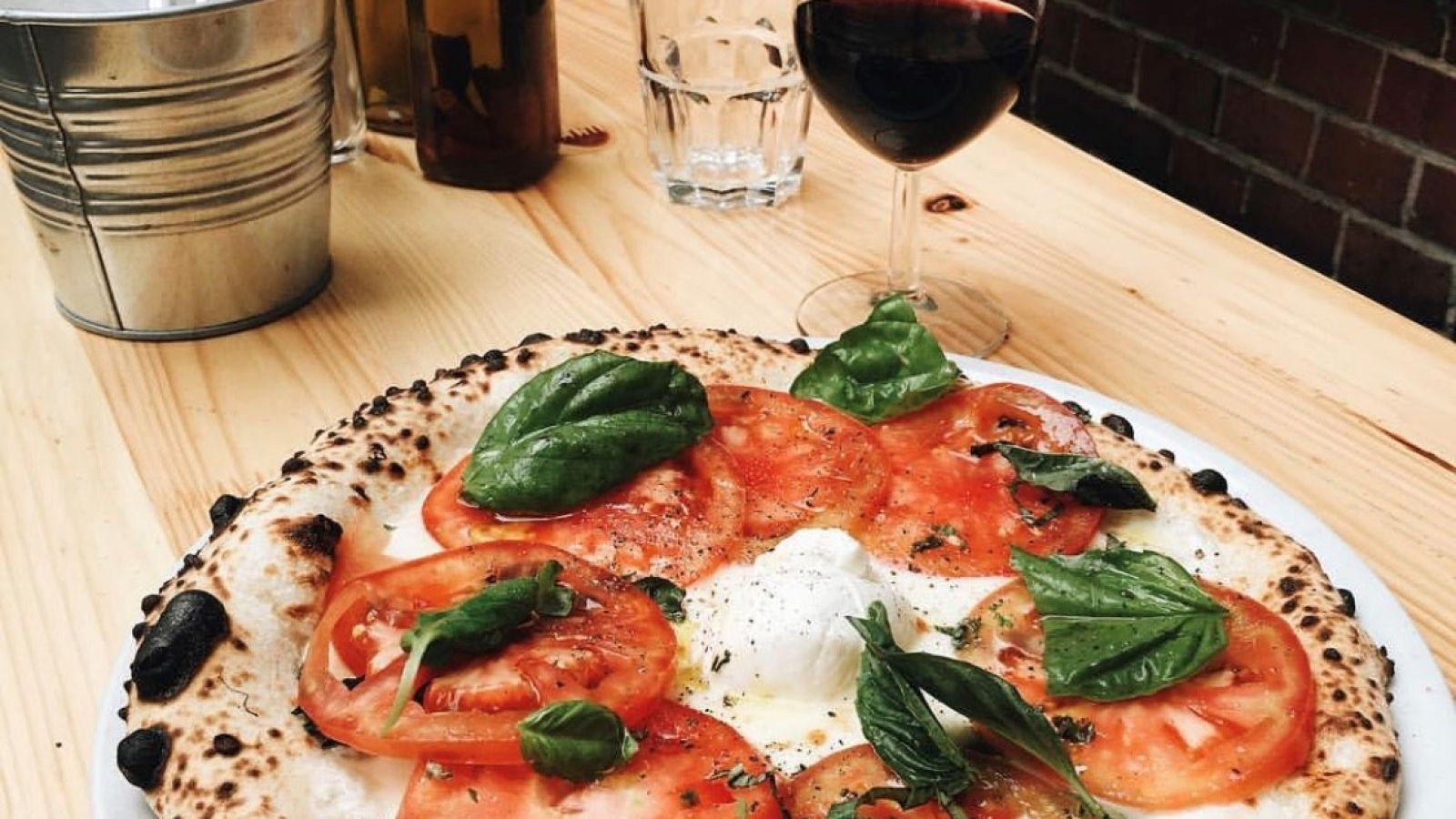 Zola makes authentic Neapolitan pizza in a fire oven. (Photo via Zola's instagram)