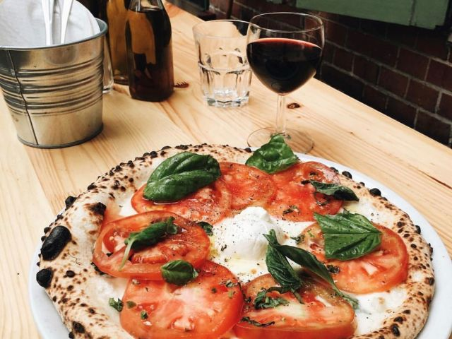 Zola makes authentic Neapolitan pizza in a fire oven. (Photo via Zola's instagram)