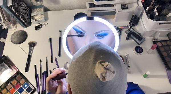 Man putting on makeup