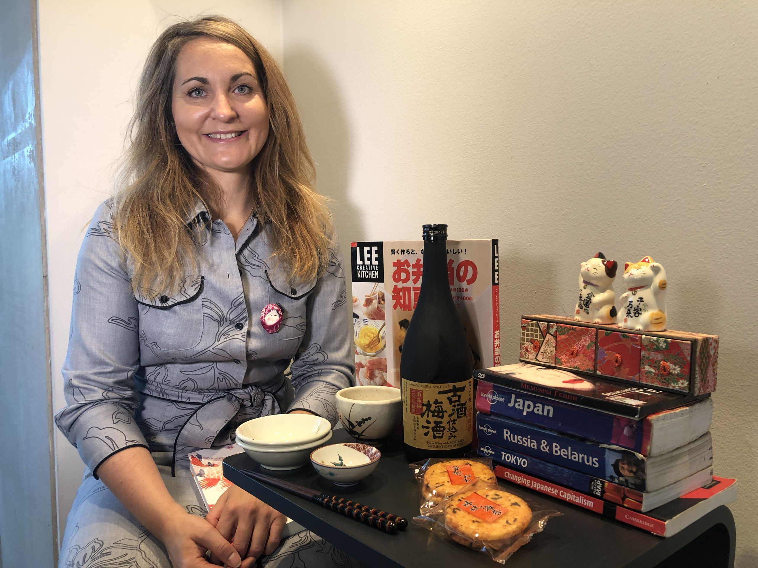 Woman sitting with Japanese things