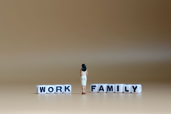 Woman between work and family