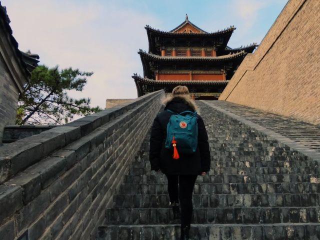 girl walking up stairs