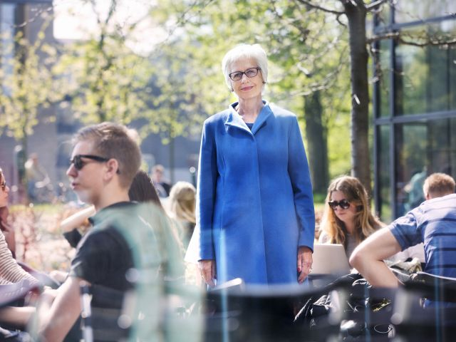 Lady in blue jacket stading outside