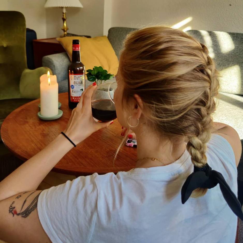 woman drinking win