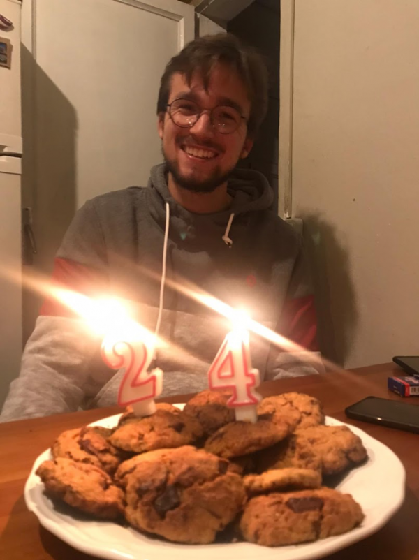 man with cookies an birthday lights (24 years old)