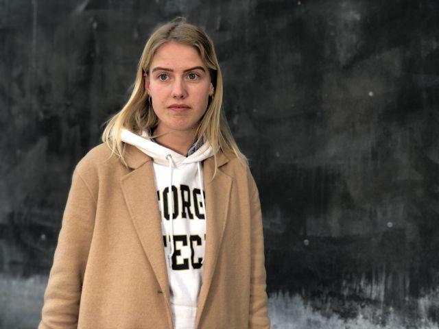 Female student in brown coat