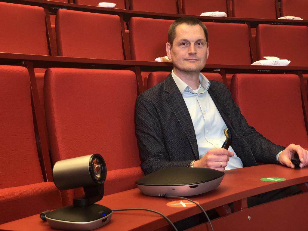 Teacher sitting in auditorium