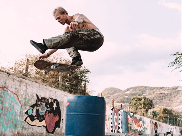 young man flying on skateboard