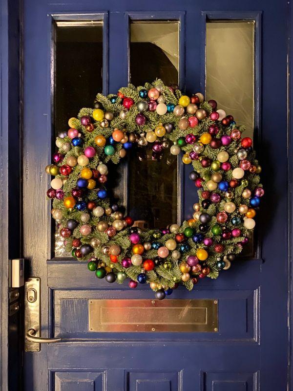 christmas wreath on blue door