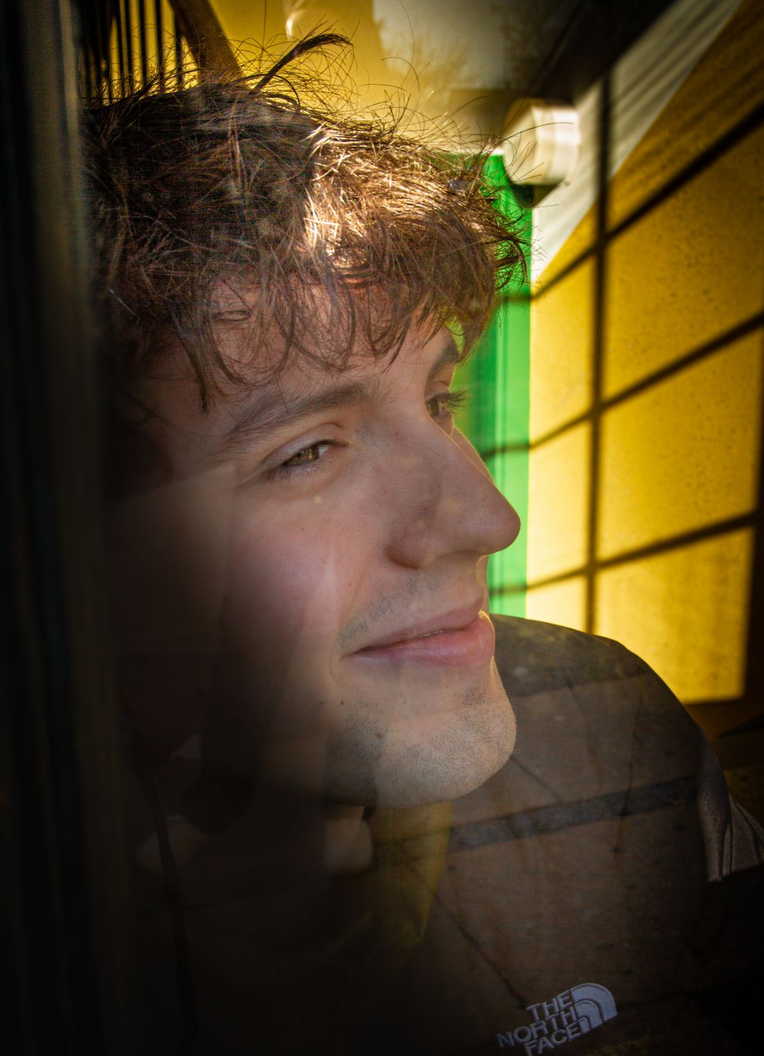 portrait of a young man - reflection in window