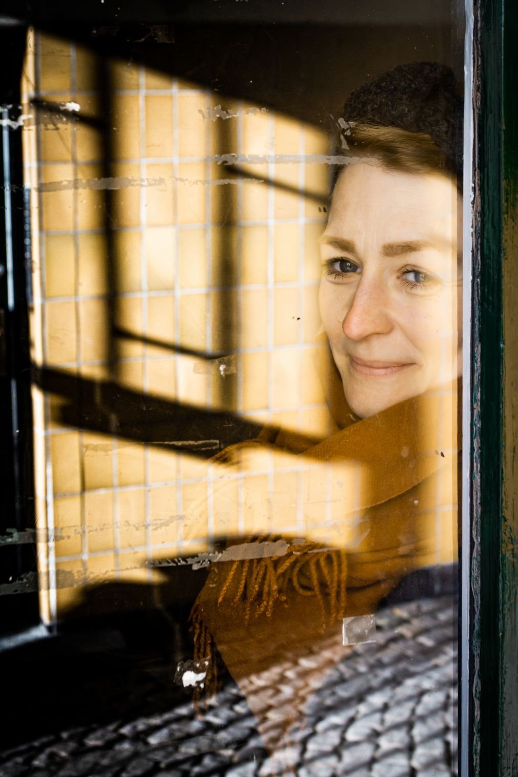 portrait of a woman - reflection in window