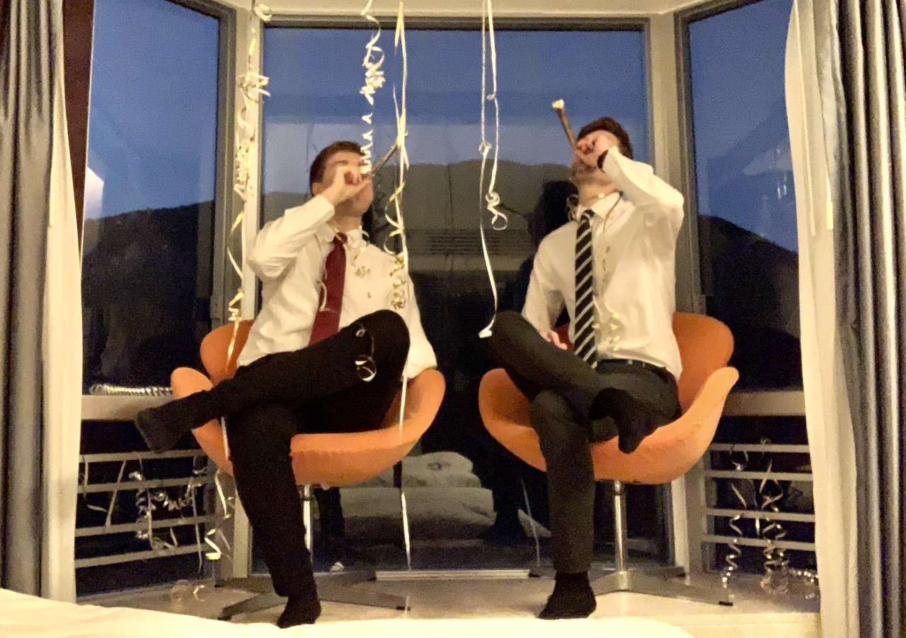 Two men in chairs
