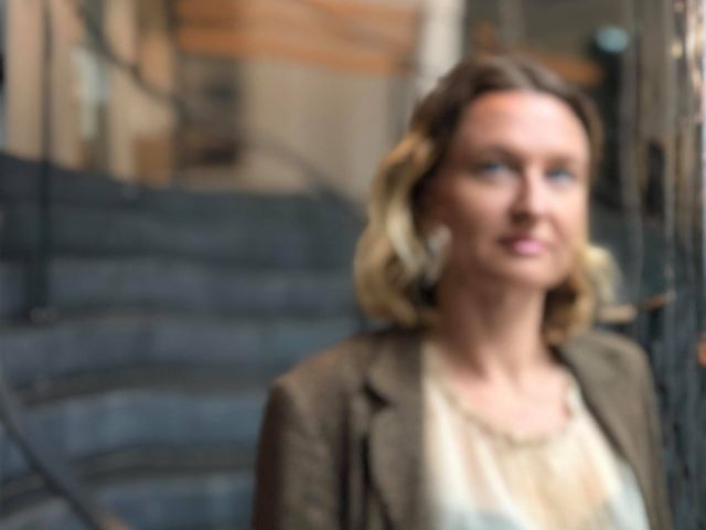 Woman looking in mirror out of focus