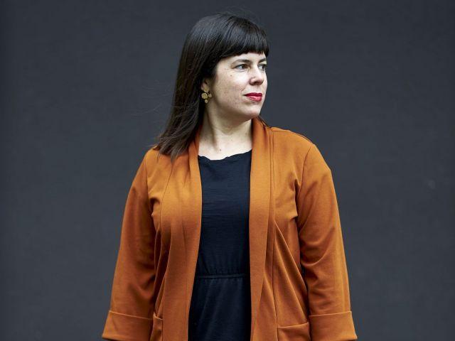 Woman in orange cardigan