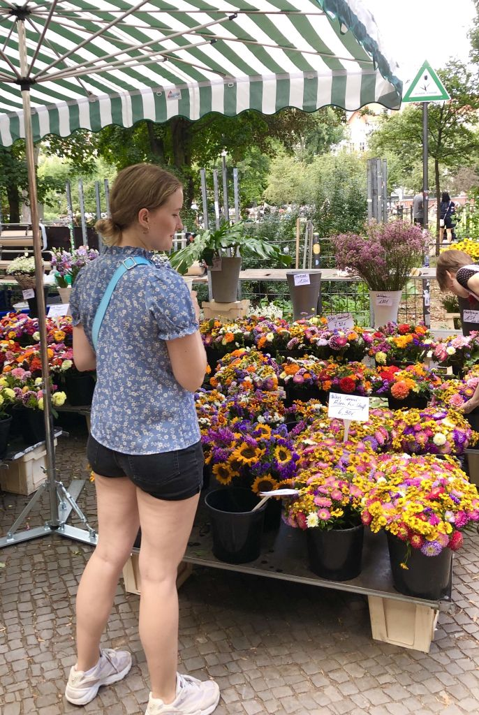 young woman at flower market