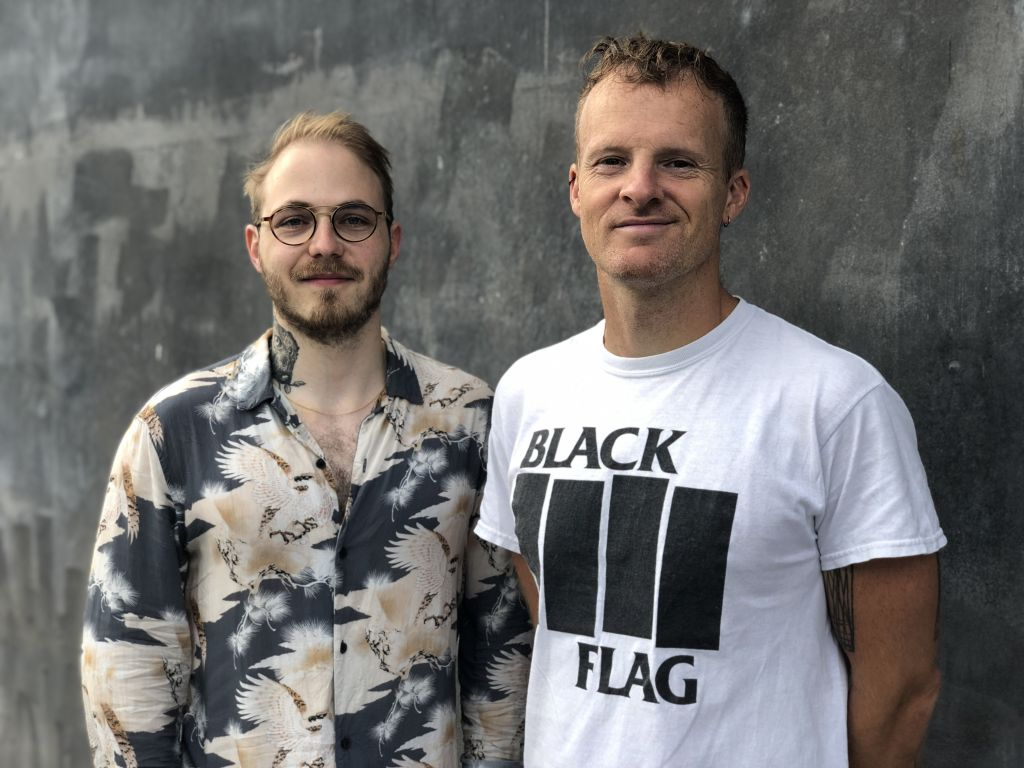 A man in a shirt and a man in a t-shirt