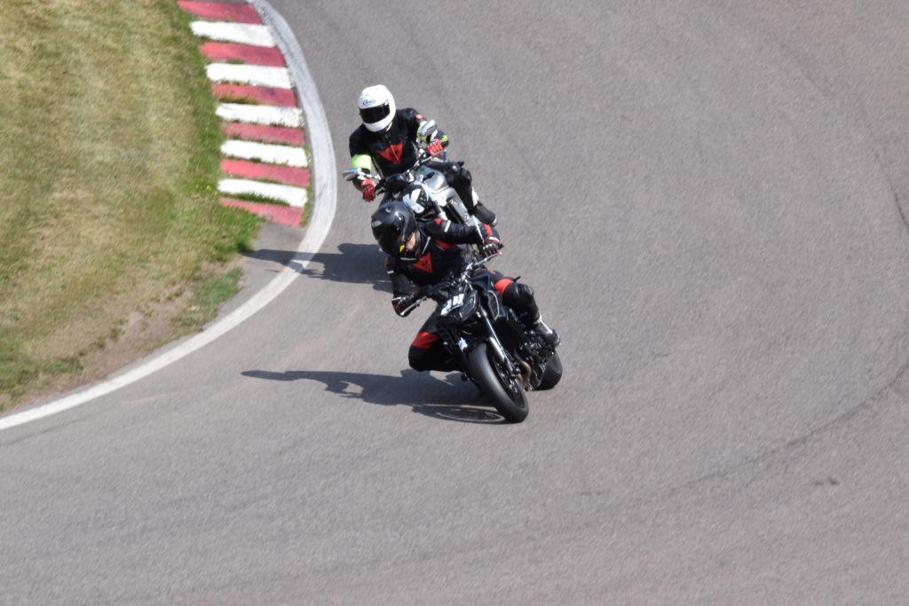 to men riding motorbikes