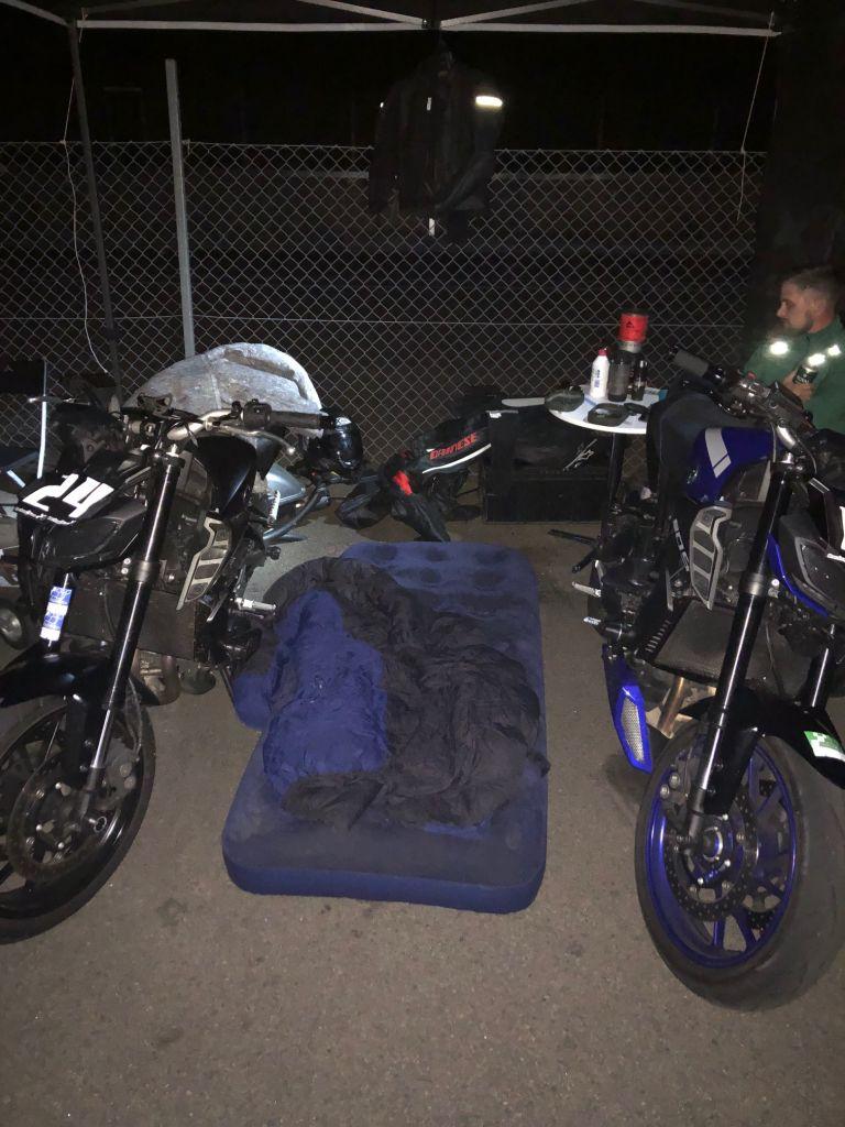 sleeping bag between motorbikes