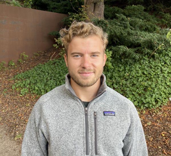 Man in grey sweater