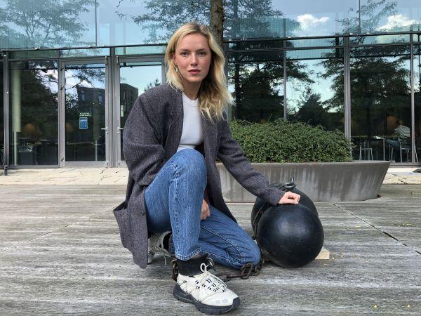 woman locked to iron sculpture