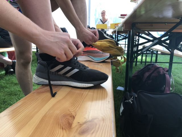 Two runners tying shoes
