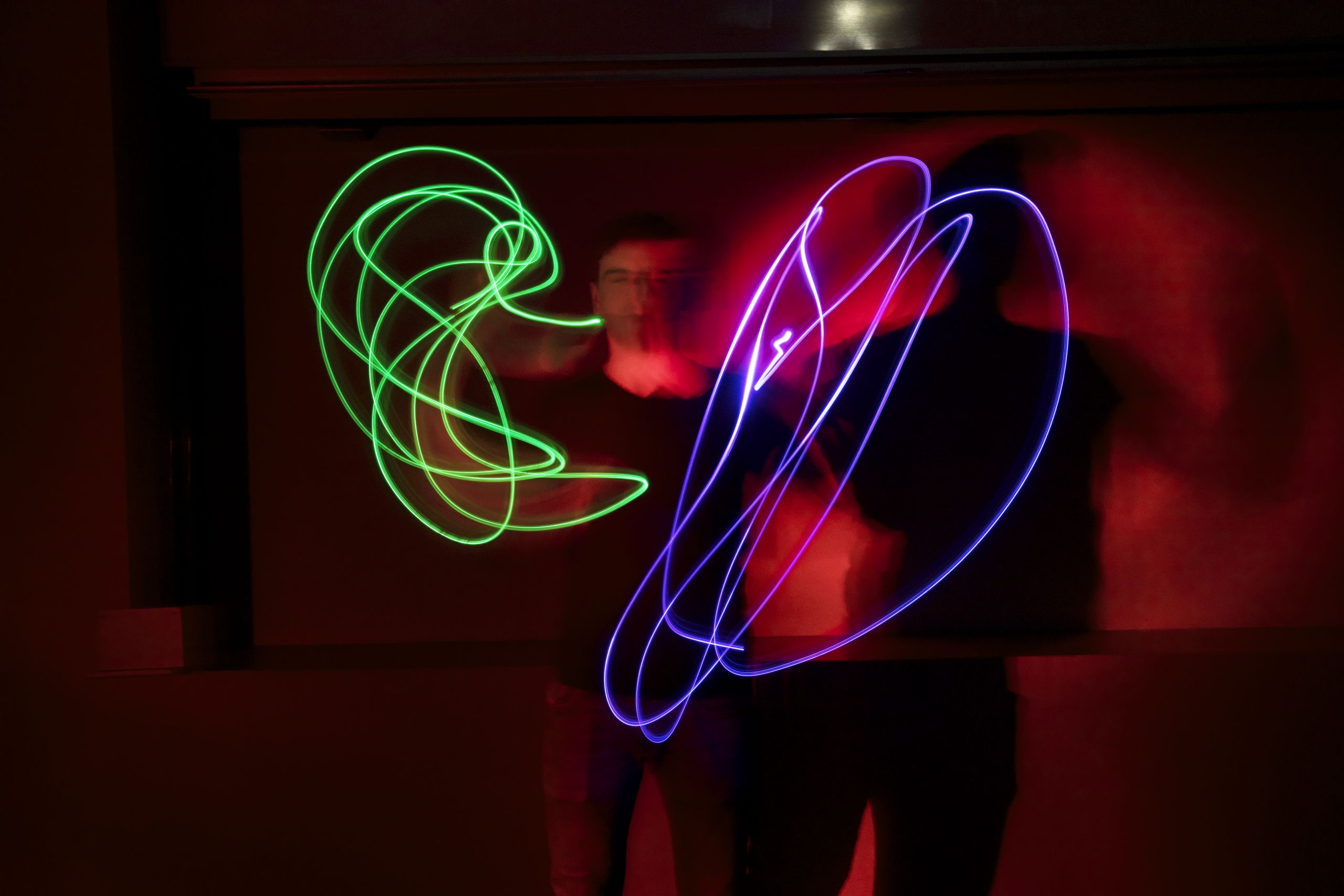 Man juggling with neon lights